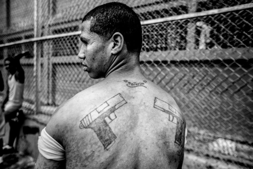 "An inmate poses for a photo showing their tattoos to his girl ""Katerin""."